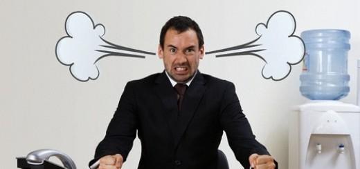 Stressed Businessman at Desk --- Image by © Simon D. Warren/zefa/Corbis