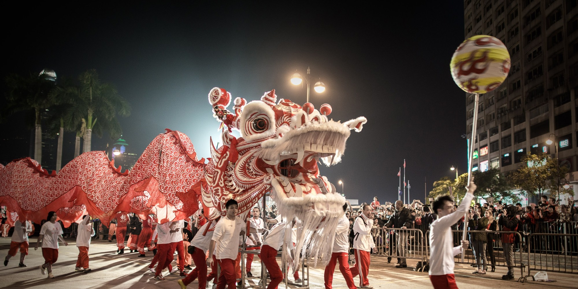 Performers display a dragon dance during a Chinese New Year parade in Hong Kong on January 31, 2014. Chinese communities across Asia have come together to usher in the Year of the Horse. AFP PHOTO/Philippe Lopez (Photo credit should read PHILIPPE LOPEZ/AFP/Getty Images)