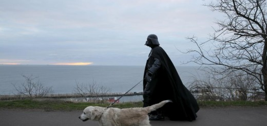 Darth Mykolaiovych Vader, who is dressed as the Star Wars character Darth Vader, poses for a picture as he walks his dog in a park in Odessa, Ukraine, December 3, 2015.  REUTERS/Valentyn Ogirenko